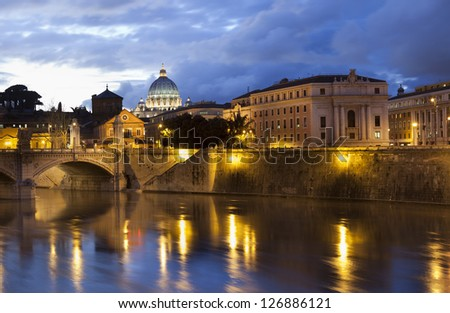 Classical view on Vatican over the Tiber river at night.