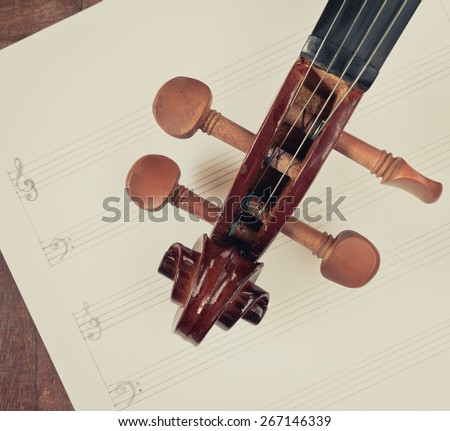 classical Violin headstock closeup on blank Music sheet + vintage filter for music composer concept background - stock photo