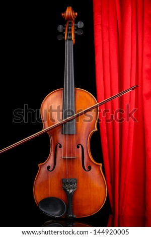 Classical violin on curtain background - stock photo