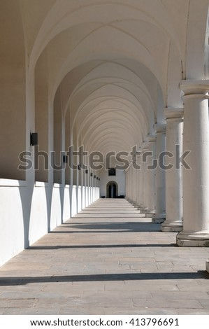 Classical white colonnade  with sharp shadows in perspective.