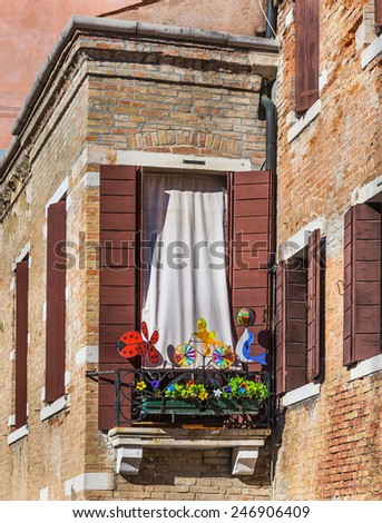 Classical window with flowers. - stock photo