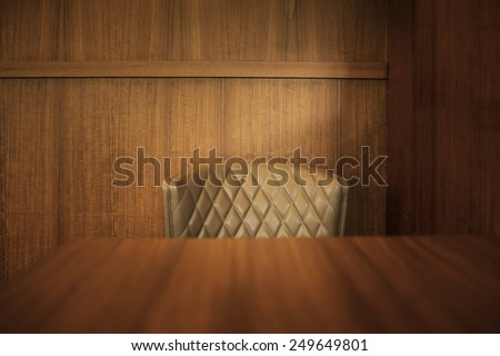 Classical wooden dining table and leather dining chair - stock photo
