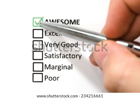 Classification choice list, hand holding silver pen. - stock photo