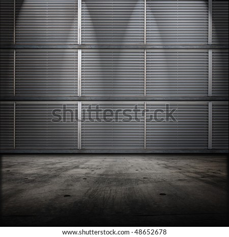 Classified room. Facility or Base type of grungy interior, with vented metal walls and concrete floor. - stock photo