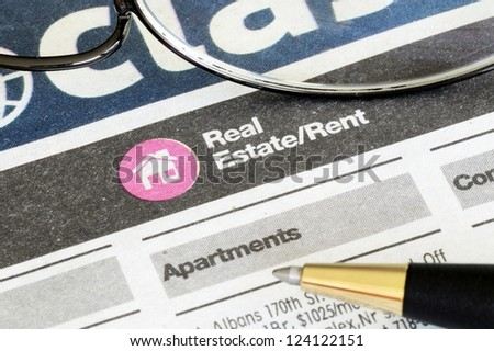 Classifieds advertisement concept of real estate sales and rental - stock photo