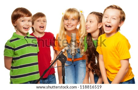Classmates singing together standing with microphone - stock photo