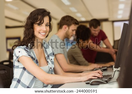 Classmates working in the computer room at the university - stock photo