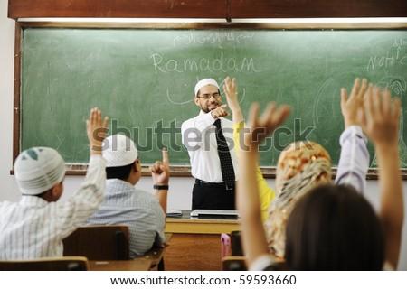 Classroom activities: teacher and children - stock photo