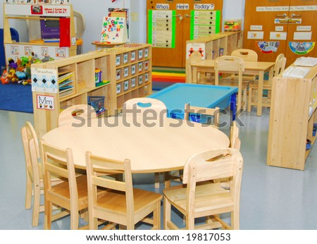 Classroom and activity stations of preschool - stock photo