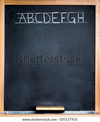 Classroom blackboard wood frame and alphabet letters - stock photo