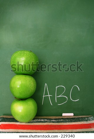 Classroom chalkboard with apples. Room at the top for text. - stock photo