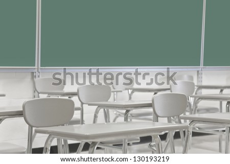 Classroom desks and chalkboard