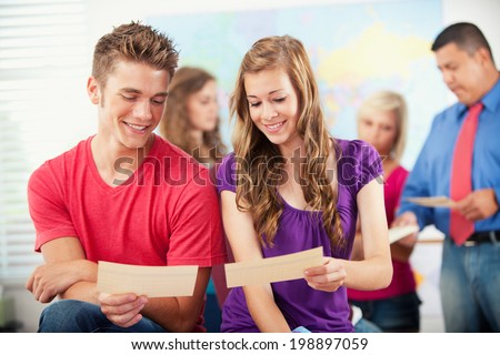Classroom: Friends Get Together To Look At Report Cards - stock photo