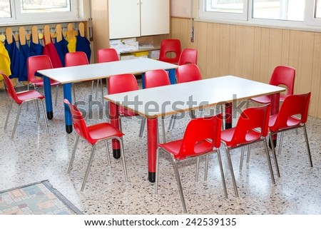 classroom nursery with small chairs and small desks for children - stock photo