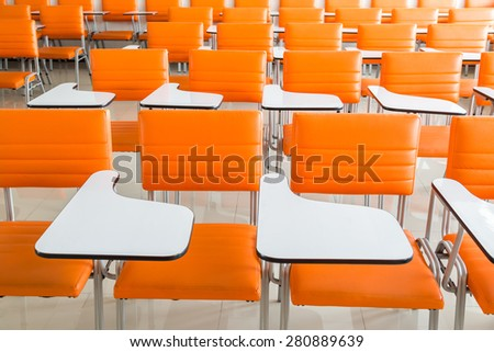 classroom with many orange armchairs background