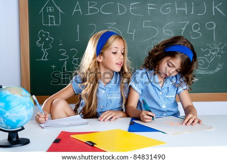 classroom with two kids students cheating on test exam at school - stock photo
