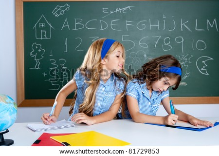 classroom with two students cheating on test exam at school