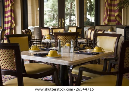 Classy and pleasant restaurant dining tables arrangement - stock photo