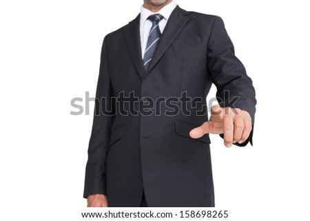 Classy businessman pointing finger on white background