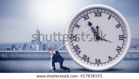 Classy businessman pulling a rope against cityscape - stock photo