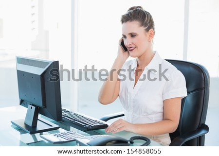 Classy businesswoman having a phone call in her office