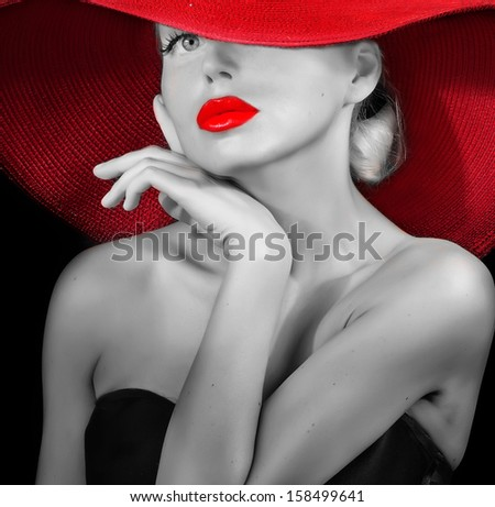 classy lady in red hat black and white portrait - stock photo