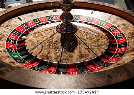 Classy Wooden Shiny Roulette Details in a Casino - stock photo