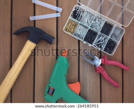 claw, hammer, glue gun and pliers - stock photo