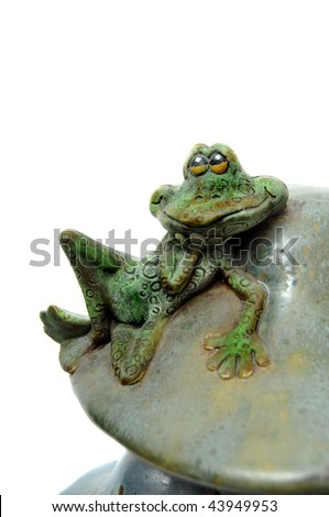 Clay art sculpture of frog resting on tall mushroom isolated on white background - stock photo