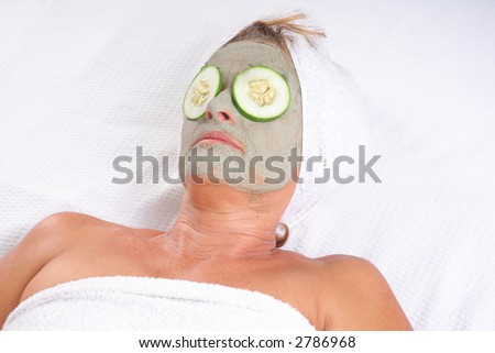 Clay Beauty Mask - Senior Woman relaxing during beauty treatment - stock photo