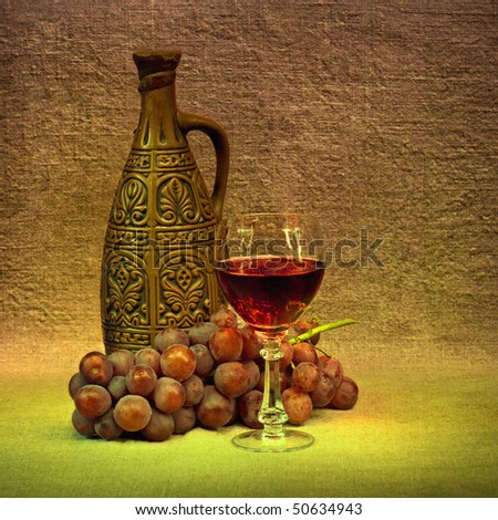 Clay bottle, glass and grapes - stock photo