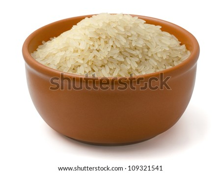 Clay bowl full of parboiled rice isolated on white - stock photo