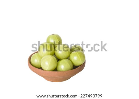 Clay Bowl with Amla (Indian gooseberries) on a white background - stock photo