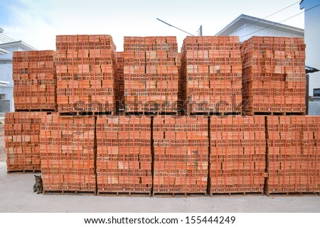 clay brick stored for building construction - stock photo