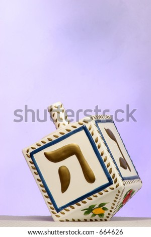clay chanukkah dreidel - stock photo