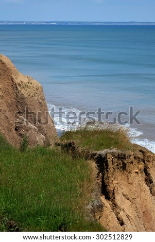 Clay cliff erosion on the east coast of Yorkshire, UK.