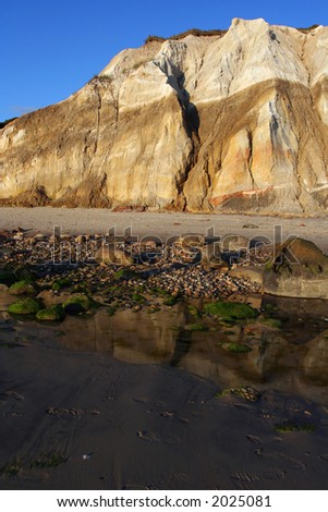Clay cliff on the edge of a tidal pool. - stock photo