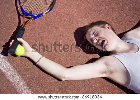Clay Court Tennis Player Cries Out For Medical Attention With An Injured Elbow - stock photo