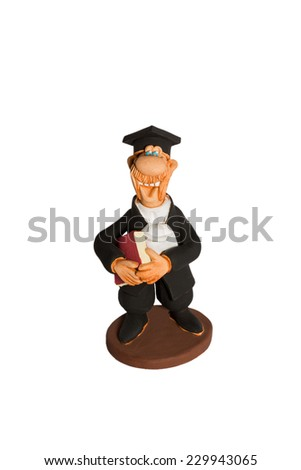 Clay figurine handmade cheerful professor in a black gown with book in hand isolated on white background - stock photo