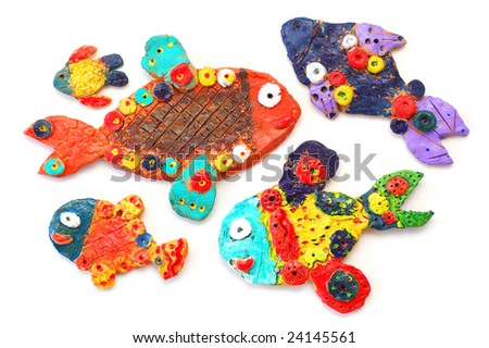 Clay fishes, isolated - stock photo