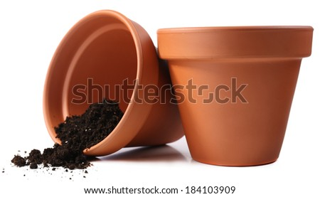 Clay flower pots and soil, isolated on white  - stock photo