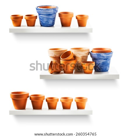 Clay flower pots on shelf collection isolated on white backgrounds - stock photo