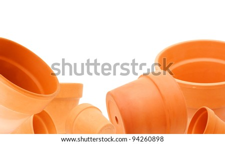 Clay flower pots on white background - stock photo