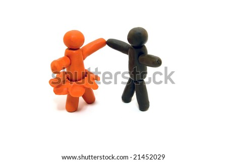Clay human figures dancing isolated on white background - stock photo
