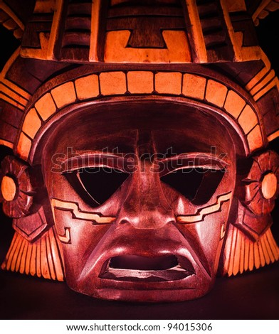 clay mask of a maya in the dark, end of the world - stock photo