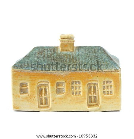 Clay model of a 19th century house, isolated on white. - stock photo