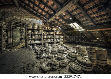 Clay molds in attic of an abandoned ceramics factory, HDR processing - stock photo