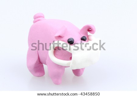 Clay pig mouth covered swine flu concept - stock photo