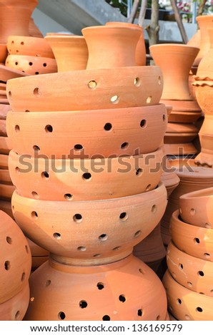Clay Plant Pots Stacked in the market flowers - stock photo