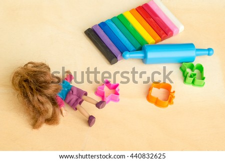 Clay(Plasticine) and toys On the wooden floor - stock photo